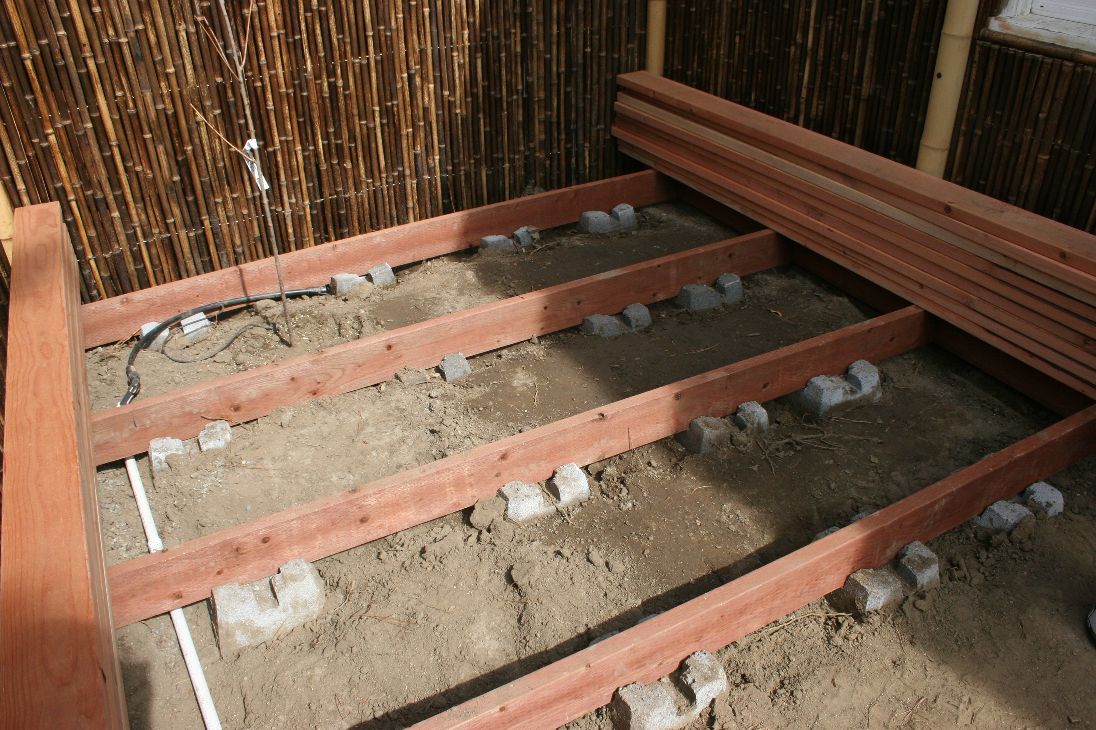 also buried each DEK Block about 4-5 inches deep to provide the ...